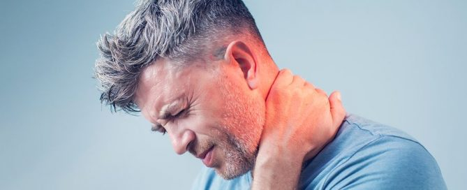 A man suffering from neck pain.